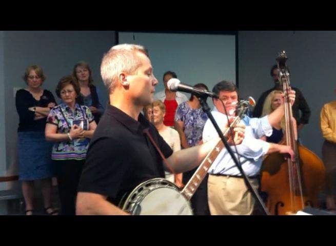 Chris Joslin playing banjo on Bluegrass Sunday